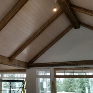 Faux Beams hand crafted from brown weathered barn boards