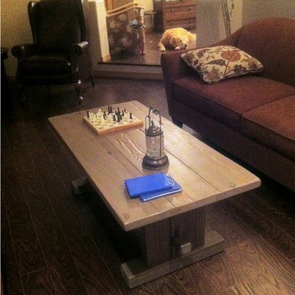 Rustic cabin coffee table designed with a pedestal base locally made using solid wood