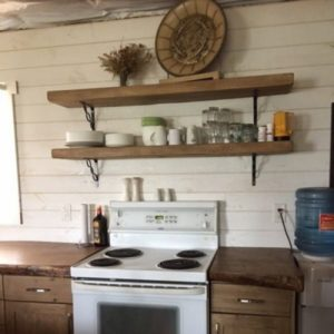 Faux shelves hand crafted from weathered barn boards