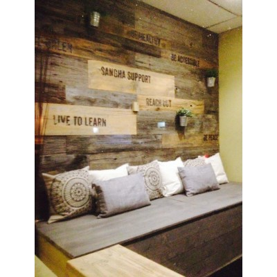 Accent wall using grey and brown weathered wood
