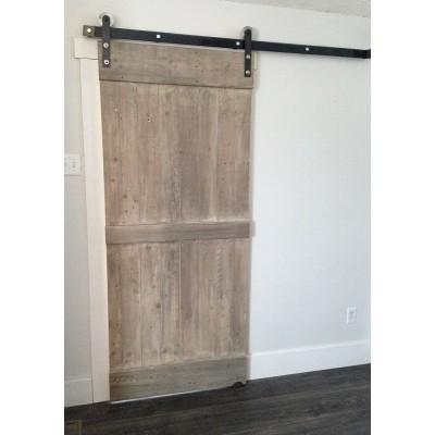 Rustic door hand crafted from reclaimed barnwood