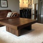 Rustic modern coffee table hand crafted with weathered wood and solid barn beams