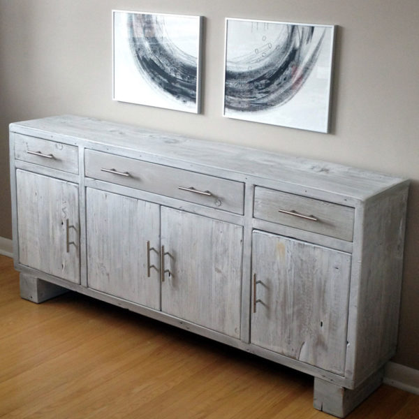 Modern design buffet hand made from localled sourced reclaimed barnwood finished off with modern hardware
