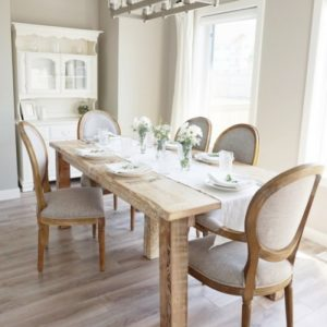 Farmhouse post and beam dining table made with solid wood barn timbers